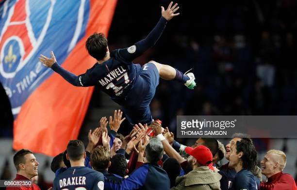 TOPSHOT Paris SaintGermain's players celebrate their teammate Brazilian defender Maxwell's last match with the team as they lift him the air at the...