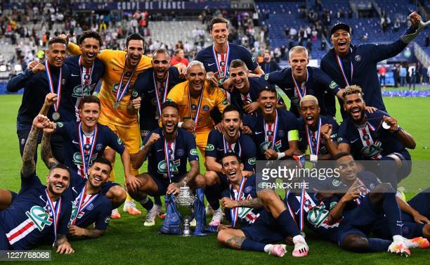 Paris Saint-Germain's players celebrate with the trophy after winning the French Cup final football match between Paris Saint-Germain and...