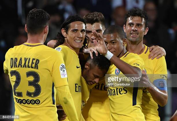 Paris SaintGermain's players German midfielder Julian Draxler Uruguayan forward Edinson Cavani Brazilian forward Neymar French forward Kylian Mbappe...