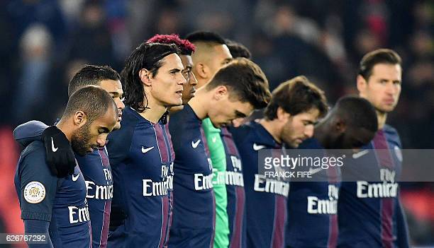 Paris SaintGermain's players observe a minute of silence to pay homage to Brazil's Chapecoense football team players who died in a plane crash late...