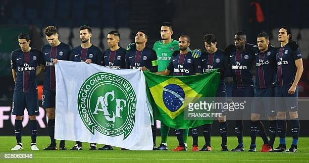 TOPSHOT Paris SaintGermain's players observe a minute's silence for the players of the Brazilian Chapecoense football team who died in a plane chrash...