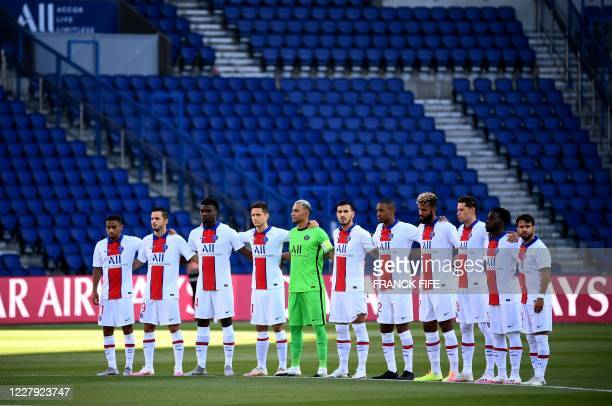 Paris Saint-Germain's players observe a minute's silence in memory of the victims of the explosion in Lebanon during the friendly football match...