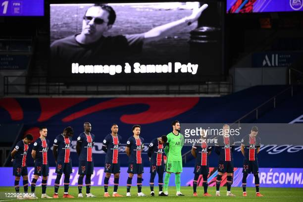 Paris Saint-Germain's players observe one minute of silence in memory of Samuel Paty prior the French L1 football match between Paris Saint-Germain...