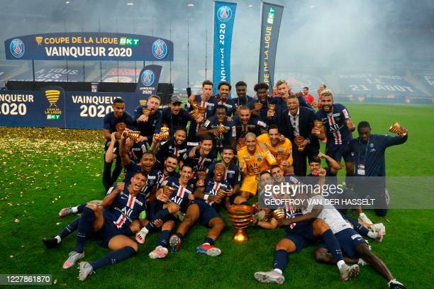 Paris Saint-Germain's players pose as they celebrate their victory at the end of the French League Cup final football match between Paris...