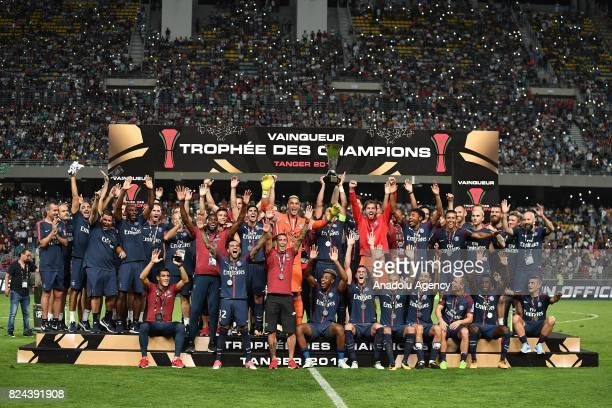 Paris SaintGermain's players pose with the trophy as they celebrate winning the French Trophy of Champions football match between Monaco and Paris...