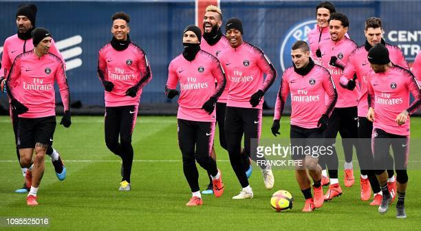 Paris SaintGermain's players take part in a training session at the team's Camp des Loges training grounds in SaintGermainenLaye west of Paris on...