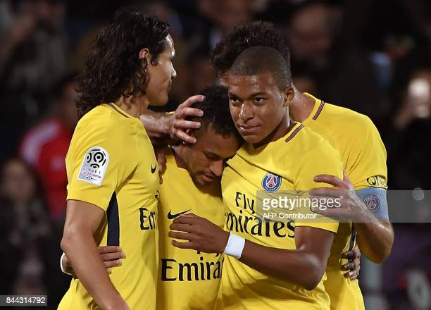 Paris SaintGermain's players Uruguayan forward Edinson Cavani Brazilian forward Neymar and French forward Kylian Mbappe celebrate following a goal...