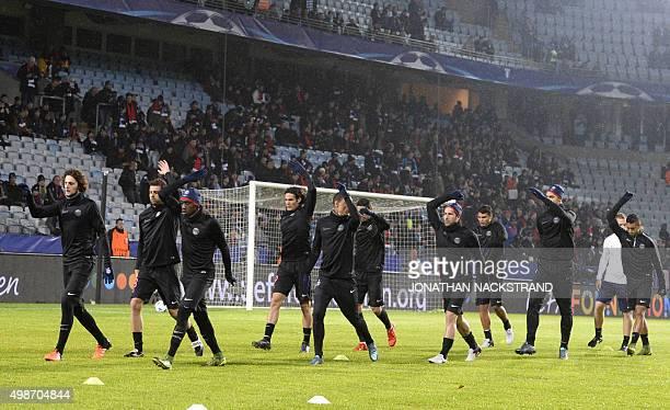 Paris SaintGermain's players warm up prior to during the UEFA Champions League Group A secondleg football match Malmo FF vs Paris SaintGermain in...