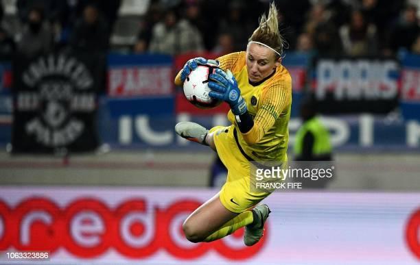 Paris Saint-Germain's Polish goalkeeper Katarzyna Kiedrzynek jumps for the ball during the French Women's D1 football match between Paris...