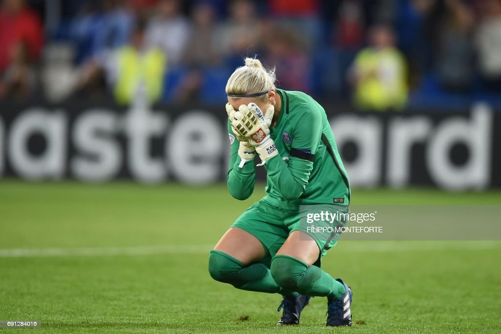 Paris Saint-Germain's Polish goalkeeper Katarzyna Kiedrzynek reacts after missing a penalty in the shoot-out during the UEFA Women's Champions League final football match between Lyon and Paris Saint-Germain at the Cardiff City Stadium in Cardiff, south Wales, on June 1, 2017. Lyon beat Paris St Germain 7-6 on penalties, to win the women's Champions League final after a goalless draw, in Cardiff. / AFP PHOTO / Filippo MONTEFORTE