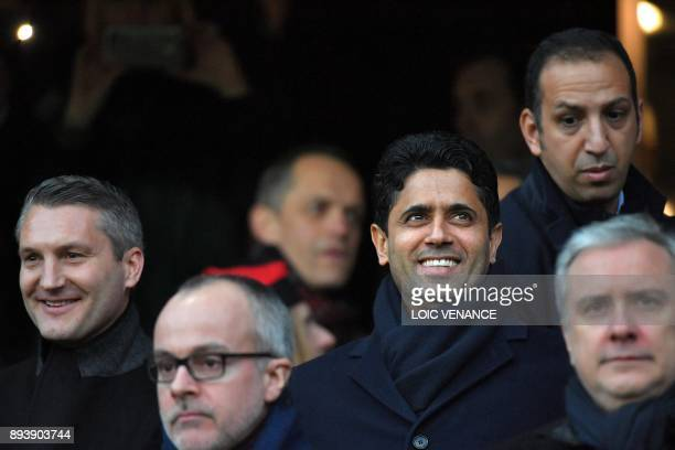 Paris SaintGermain's Qatari president Nasser AlKhelaïfi and Rennes' French club president Olivier Letang attend the French L1 football match between...