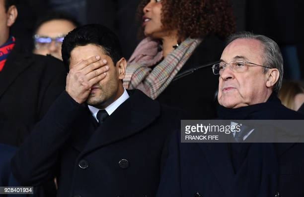 TOPSHOT Paris SaintGermain's Qatari president Nasser AlKhelaifi grimaces next to Real Madrid's Spanish president Florentino Perez as they attend the...