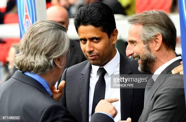 Paris SaintGermain's Qatari President Nasser AlKhelaifi speaks with Montpellier's French VicePresident Laurent Nicollin and Paris SaintGermain's...