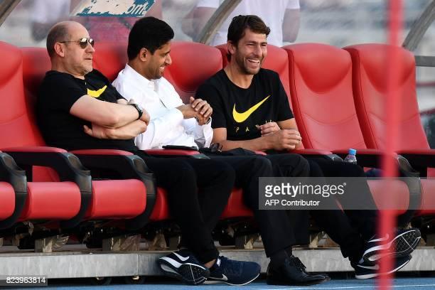 Paris SaintGermain's Qatari president Nasser AlKhelaifi speaks with Paris SaintGermain's Portuguese sporting director Antero Henrique and deputy...