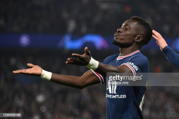 Paris Saint-Germain's Senegalese midfielder Idrissa Gana Gueye celebrates after scoring a goal during the UEFA Champions League first round group A...