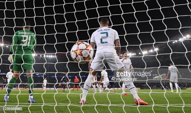 Paris Saint-Germain's Senegalese midfielder Idrissa Gana Gueye celebrates scoring his team's first goal during the UEFA Champions League first round...