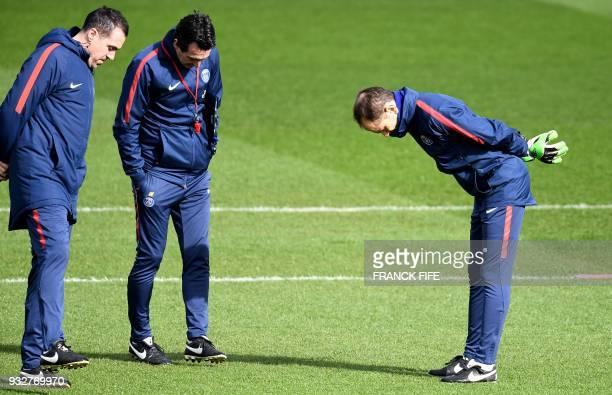 Paris SaintGermain's Spanish assistant coach Juan Carlos Carcedo headcoach Unai Emery and goalkeeping coach Javi Garcia look at the pitch during a...