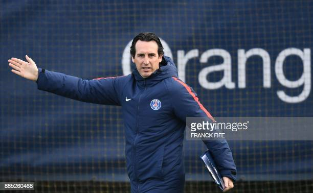 Paris SaintGermain's Spanish coach Unai Emery gestures during a training session in SaintGermainenLaye western Paris on December 4 on the eve of the...