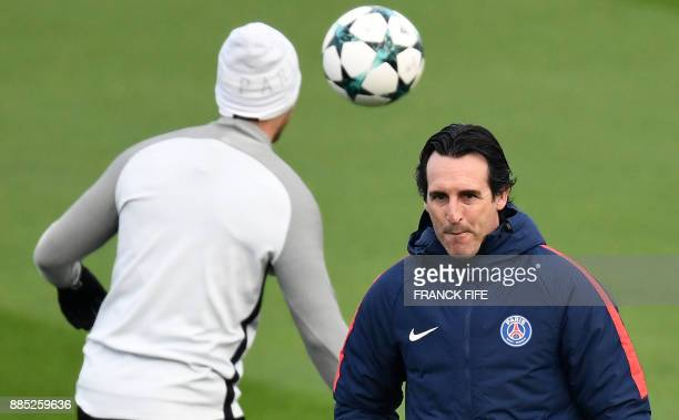 Paris SaintGermain's Spanish coach Unai Emery looks on during a training session in SaintGermainenLaye western Paris on December 4 on the eve of the...