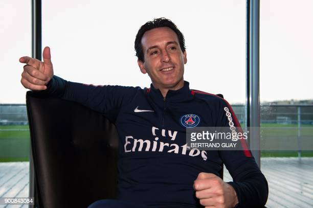 Paris SaintGermain's Spanish coach Unai Emery poses during a photo session in SaintGermainenLaye western Paris on January 3 2018 / AFP PHOTO /...