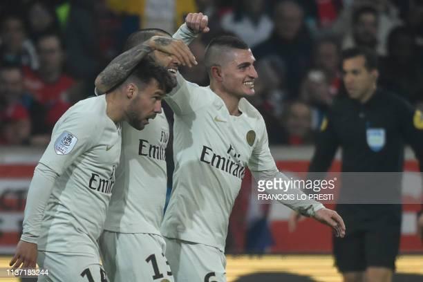 Paris SaintGermain's Spanish defender Juan Bernat is congratulated by Paris SaintGermain's Brazilian defender Dani Alves and Paris SaintGermain's...