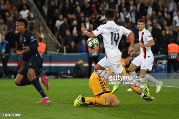 Paris Saint-Germain's Spanish defender Juan Bernat passes the ball to Paris Saint-Germain's Belgian defender Thomas Meunier during the goal action in...