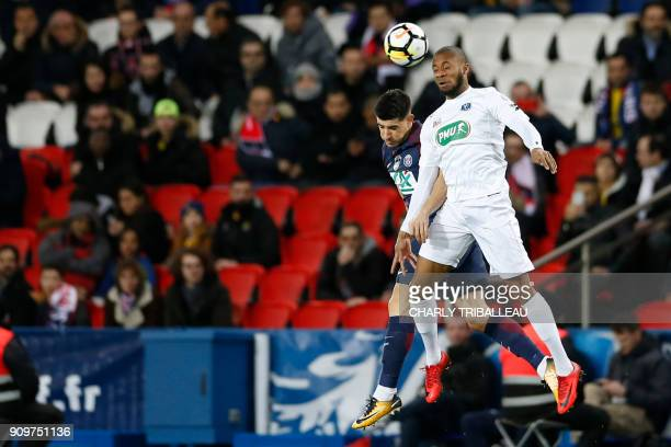 Paris SaintGermain's Spanish defender Yuri Berchiche jumps for the ball with Guingamp's French midfielder Marcus Coco during the French Cup round of...