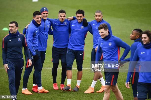 Paris SaintGermain's Spanish defender Yuri Berchiche Paris SaintGermain's Uruguayan forward Edinson Cavani Paris SaintGermain's French forward Hatem...