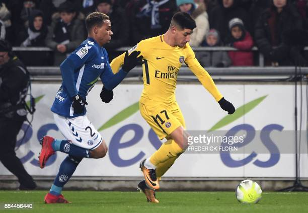 Paris SaintGermain's Spanish defender Yuri Berchiche vies for the ball with Strasbourg's French defender Kenny Lala during the French L1 football...