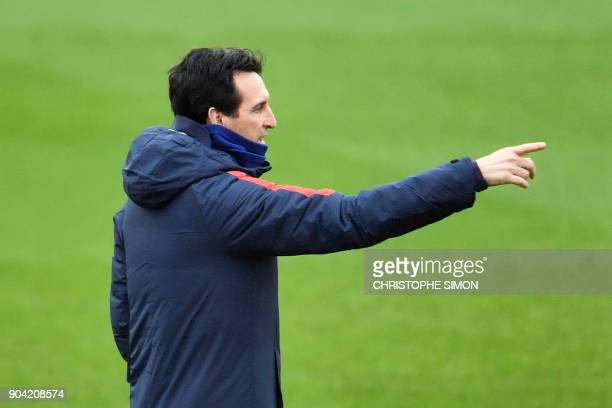 Paris SaintGermain's Spanish head coach Unai Emery gestures during a training session on January 12 2018 at the Camp des Loges in SaintGermainenLaye...