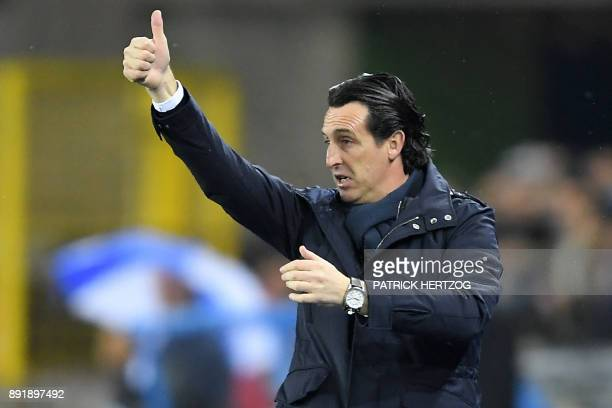 Paris SaintGermain's Spanish head coach Unai Emery gives his instructions during the French League Cup round of 16 football match between Strasbourg...