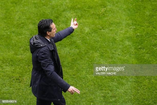 Paris SaintGermain's Spanish head coach Unai Emery reacts during the French L1 football match Nice vs Paris SaintGermain on March 18 2018 at the...
