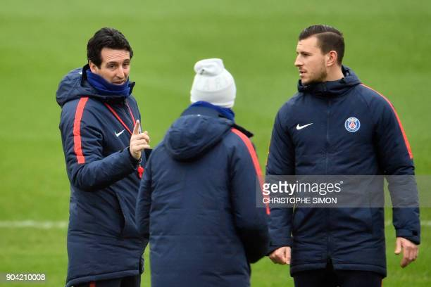 Paris SaintGermain's Spanish head coach Unai Emery speaks to members of his staff during a training session on January 12 2018 at the Camp des Loges...