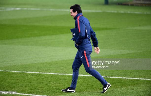 Paris SaintGermain's Spanish headcoach Unai Emery arrives for a training session at SaintGermainenLaye western Paris on March 16 two days before the...