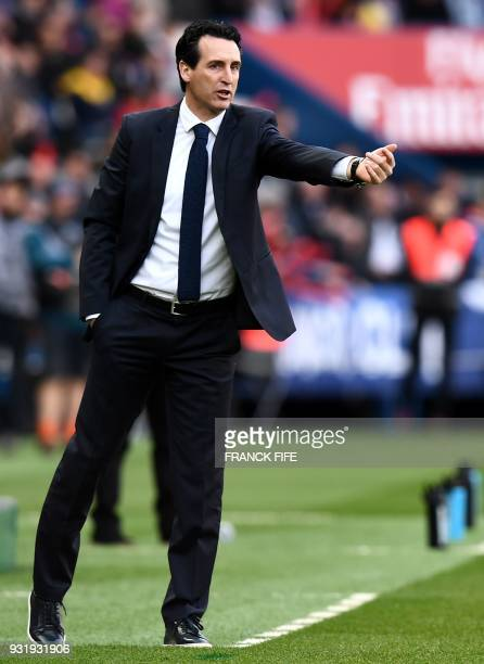 Paris SaintGermain's Spanish headcoach Unai Emery gestures as he shouts instructions to his players during the French Ligue 1 football match between...
