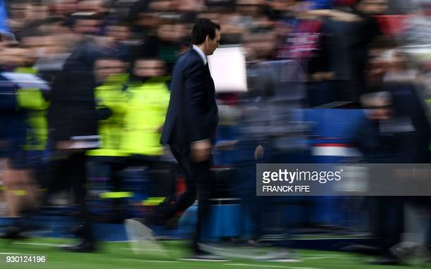 Paris SaintGermain's Spanish headcoach Unai Emery leaves the pitch at the end of the French Ligue 1 football match between Paris SaintGermain and...