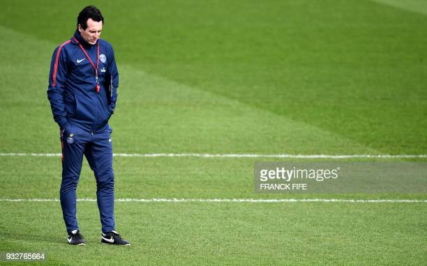 Paris SaintGermain's Spanish headcoach Unai Emery looks on during a training session at SaintGermainenLaye western Paris on March 16 two days before...