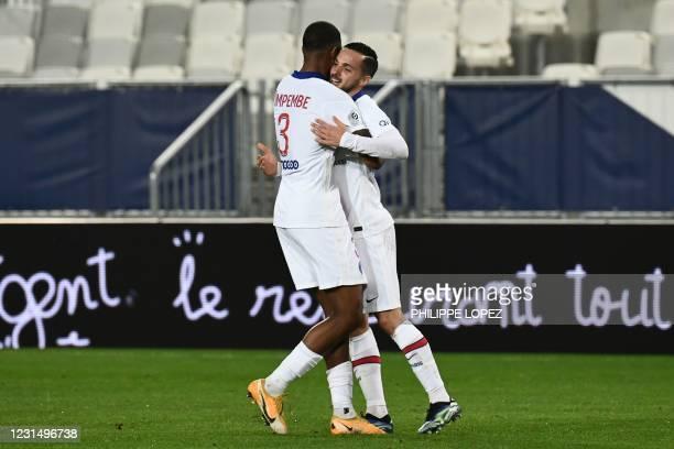 Paris Saint-Germain's Spanish midfielder Pablo Sarabia celebrates scoring his team's first goal with Paris Saint-Germain's French defender Presnel...