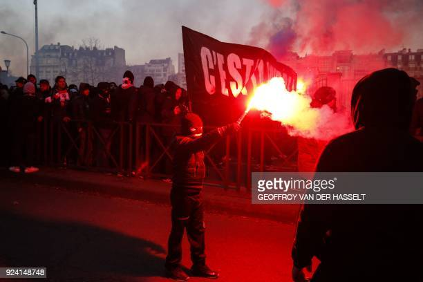 Paris SaintGermain's supporter holds a flare outside the Parc des Princes stadium in Paris prior to the French L1 football match between Paris...