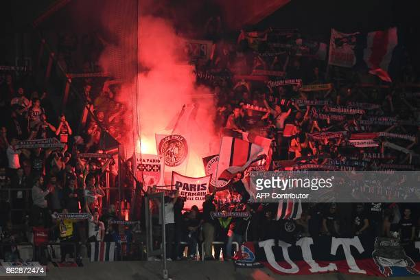 Paris Saint-Germain's supporters burn flares during the UEFA Champions League Group B football match between RSC Anderlecht and Paris Saint-Germain...
