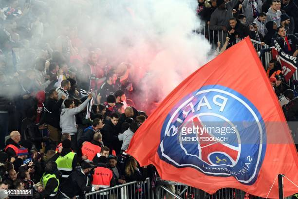 Paris SaintGermain's supporters celebrate after victory in the French League Cup final football match between Monaco and Paris SaintGermain at The...