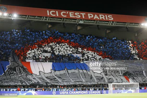 Paris Saint-Germain's supporters cheer at the start of the UEFA Champions league Group A football match between Paris Saint-Germain and Real Madrid,...