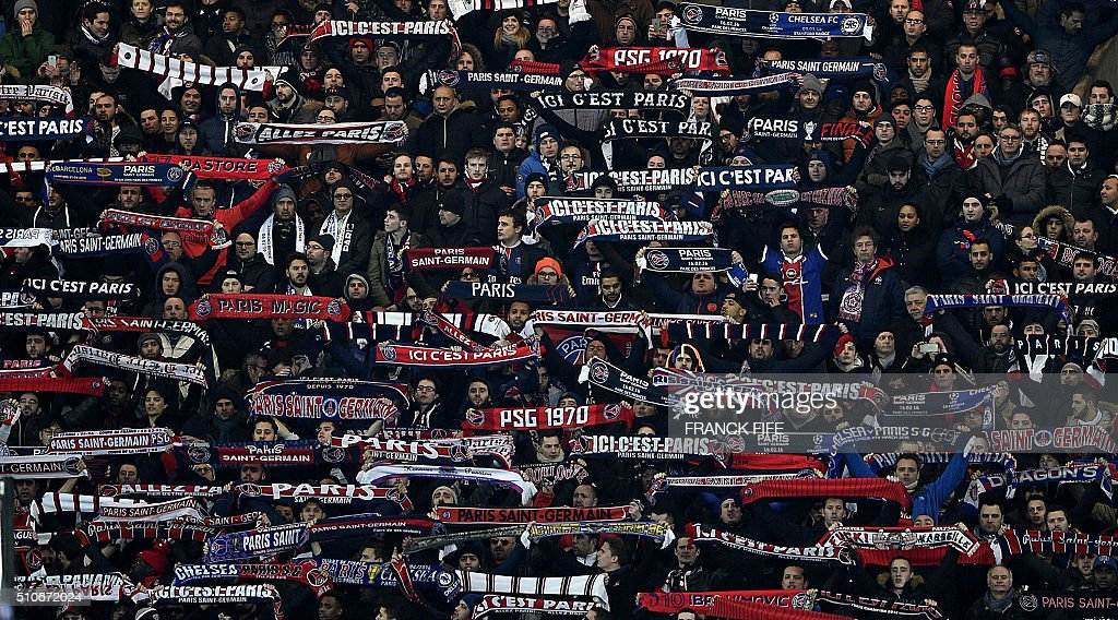 TOPSHOT - Paris Saint-Germain's supporters cheer during the Champions League round of 16 first leg football match between Paris Saint-Germain (PSG) and Chelsea FC on February 16, 2016, at the Parc des Princes stadium in Paris.