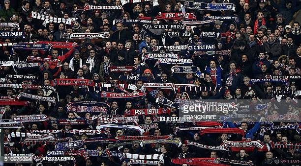 TOPSHOT Paris SaintGermain's supporters cheer during the Champions League round of 16 first leg football match between Paris SaintGermain and Chelsea...
