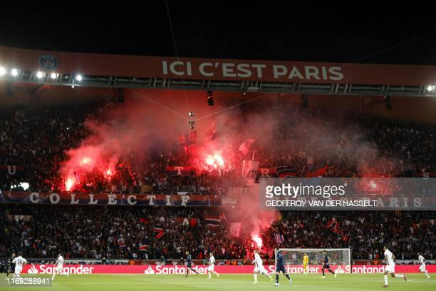 Paris Saint-Germain's supporters cheer during the UEFA Champions league Group A football match between Paris Saint-Germain and Real Madrid, at the...