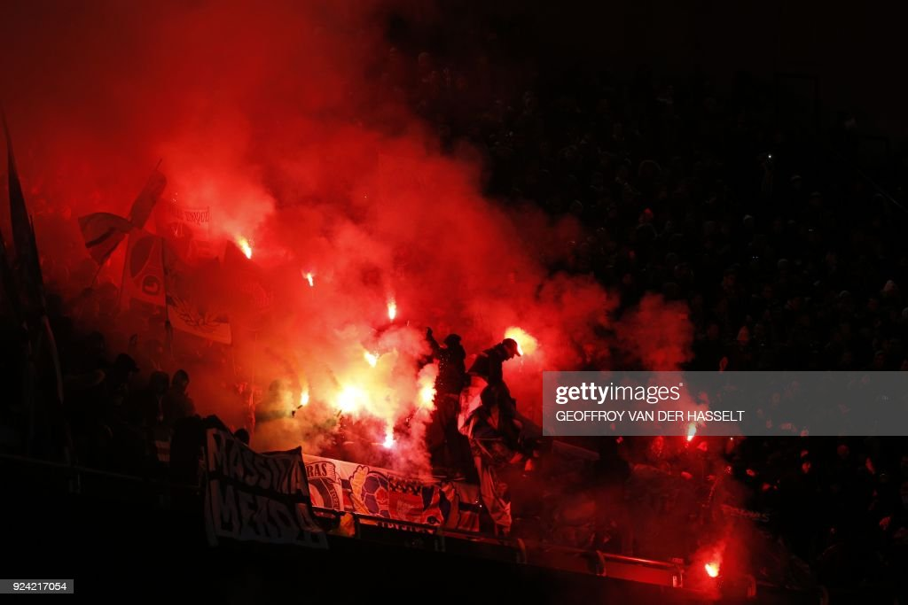 Paris Saint-Germain's supporters cheer with flares and flags during the French L1 football match between Paris Saint-Germain (PSG) and Marseille (OM) at the Parc des Princes in Paris on February 25, 2018. /