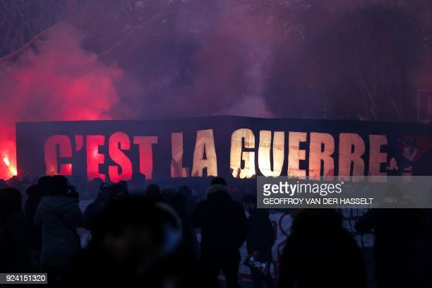 Paris SaintGermain's supporters hold a banner reading It's war outside the Parc des Princes stadium in Paris prior to the French L1 football match...