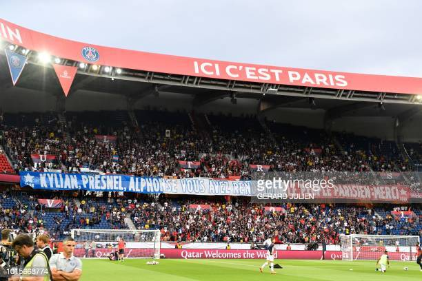 """Paris Saint-Germain's supporters hold a banner reading """"Kylian, Presnel, Alphonse, you have made the Parisian people proud, thank you"""" prior to the..."""
