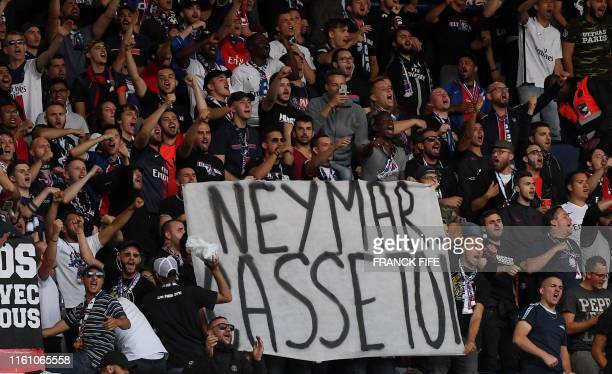 TOPSHOT Paris SaintGermain's supporters hold a banner reading Neymar buzz off prior to the French L1 football match between Paris SaintGermain and...
