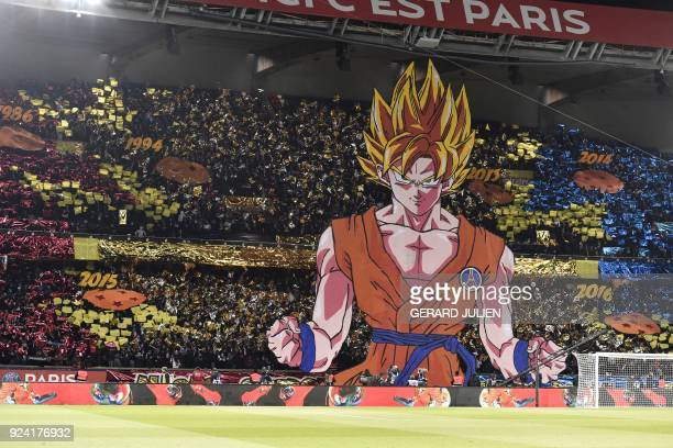 Paris SaintGermain's supporters hold a tifo representing a character of Japanese manga Dragon ball prior to the French L1 football match between...
